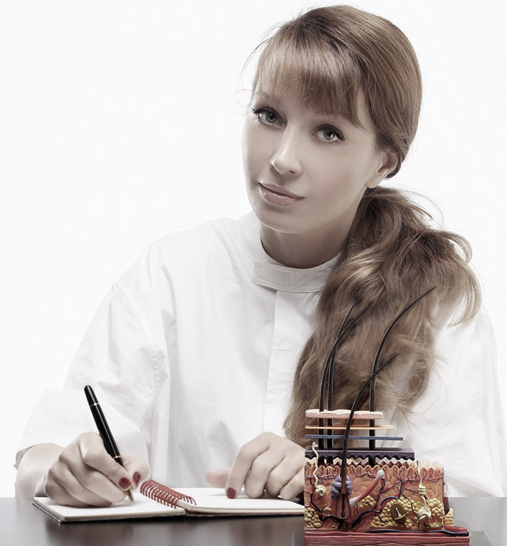 Woman doctor working at her desk on white background